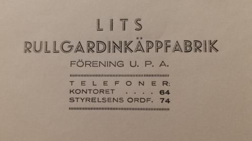 En gammal gulnad papperslapp med telefonnummer till Lits rullgardinkäppfabrik.